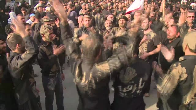 in the iraqi shiite shrine city of karbala millions of black clad faithful braved the risk of attack by sunni extremists on friday to beginning... - shi'ite islam stock videos & royalty-free footage
