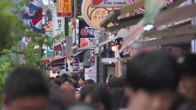 in the little seoul area of tokyo japanese shoppers flock to get their fix of kpop and korean face cream seemingly shrugging off a deep freeze in... - shrugging stock videos and b-roll footage