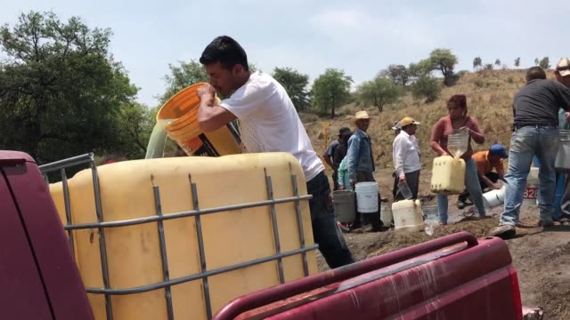 in the mexican state of puebla where gas theft has been a common occurrence dozens of people fill up tanks at an illegal outlet in front of local... - occurrence stock videos & royalty-free footage