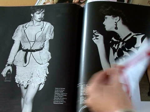 in the midst of a crisis that has battered even the bottom lines of even bestselling fashion magazines italian publishers mondadori are rolling out... - film montage stock videos & royalty-free footage
