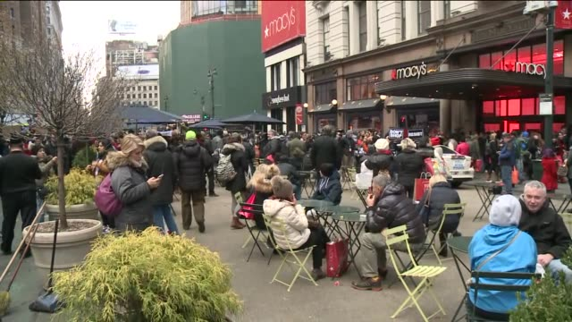 In the midst of Black Friday shopping dozens of protesters gathered outside the Macy's store in Herald Square to protest the grand jury decision to...
