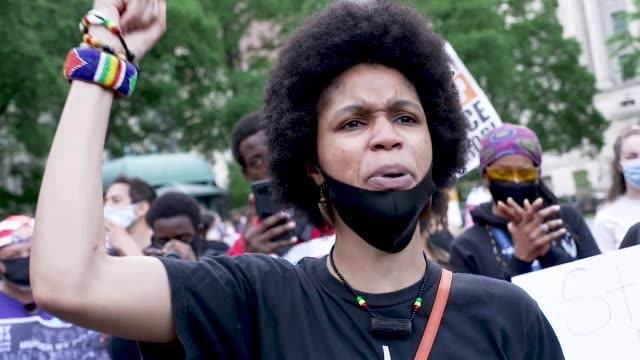 in the midst of the coronavirus disease pandemic demonstrators rally at foley square in downtown manhattan and marched to the brooklyn bridge entry... - minnesota stock-videos und b-roll-filmmaterial