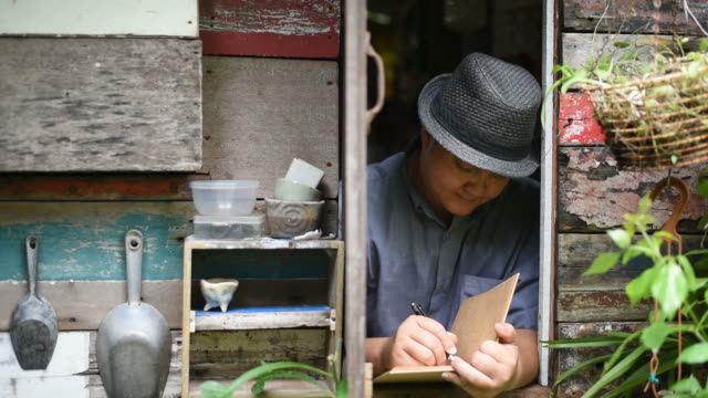 in the morning the asian man writes in the diary at the vintage window. - diary stock videos & royalty-free footage