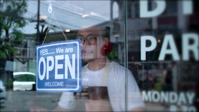 in the morning, the owner of a small business shop came to open the shop. - opening event stock videos & royalty-free footage