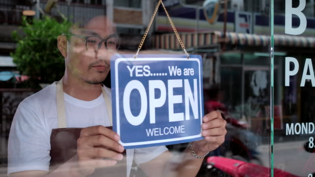 in the morning, the owner of a small business shop came to open the shop. - east asian ethnicity stock videos & royalty-free footage