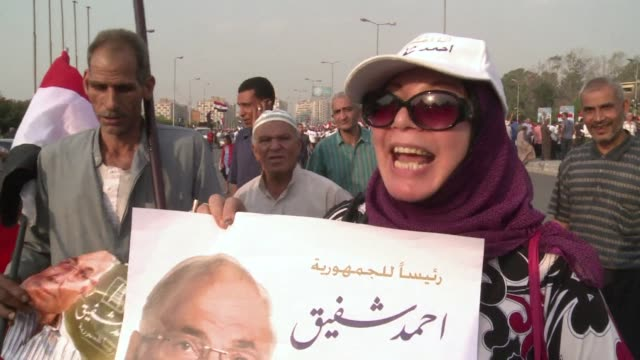 in the nasr city neighbourhood of cairo thousands of shafiq supporters rallied saturday in support of the army holding up pictures of their candidate... - field marshal stock videos and b-roll footage