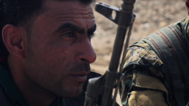 vídeos de stock, filmes e b-roll de in the north of the country turkishbacked militias are fighting kurdish troops supported by us special forces and air power near manbij our special... - curdo