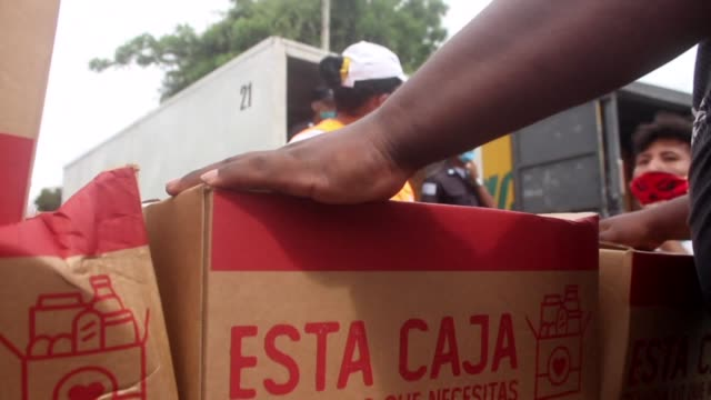 in the pacific port city of guayaquil in ecuador, government workers go door-to-door to deliver food and give medical care and advice to residents in... - pacific war stock-videos und b-roll-filmmaterial