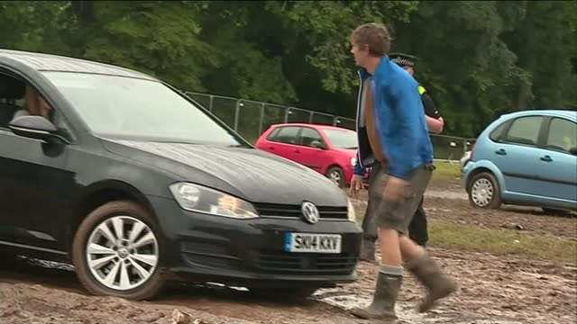 t in the park music fans stranded in muddy conditions scotland perthshire strathallan castle ext festivalgoer pushing his car out of the mud more... - perthshire stock videos & royalty-free footage