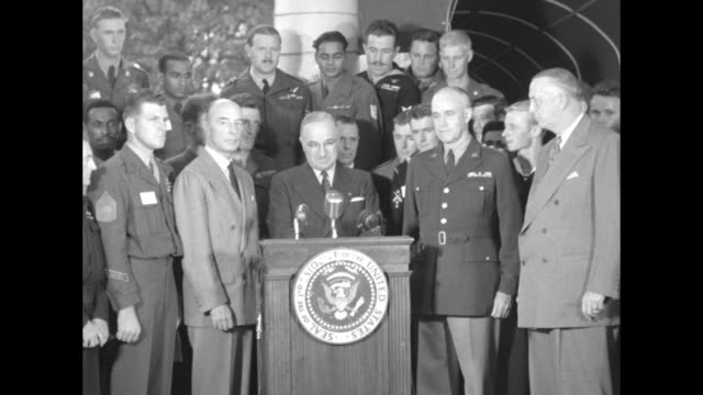 in the portico outside his office president harry truman takes the podium on united nations day surrounded by men of armed forces from 19 un... - joint chiefs of staff stock videos and b-roll footage