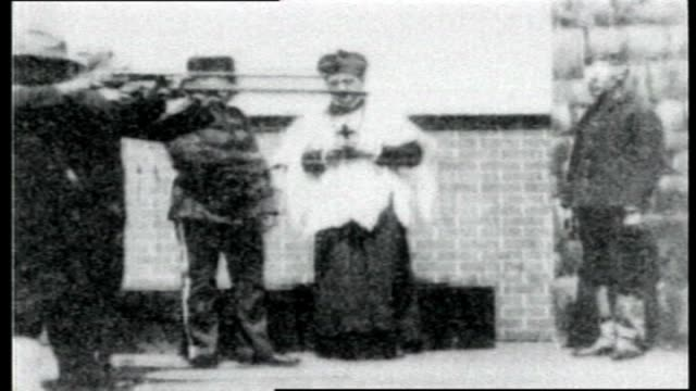 in the presence of a priest american army troops in standard military position fire upon a man who is bound and blindfolded [almost certainly a fake] - priest stock videos and b-roll footage