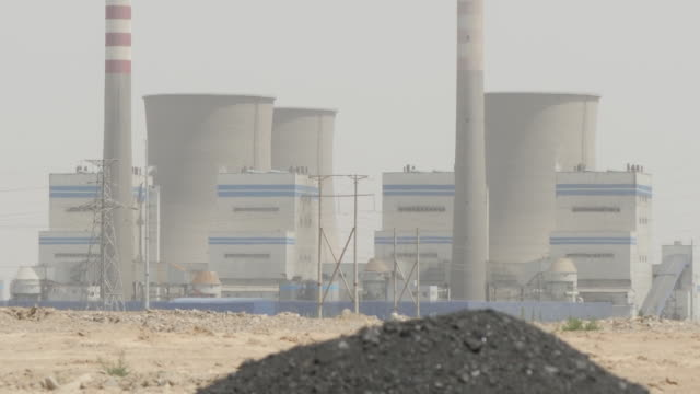 in the race to tackle climate change china has pronounced itself as a global leader it is the world's biggest investor in renewable energy but it is... - fossil fuel stock videos & royalty-free footage