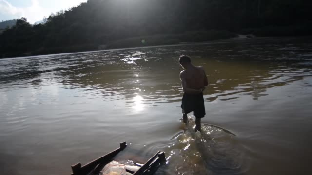 In the river that separates Thailand from Myanmar a Karen family can enjoy the time of daily hygiene