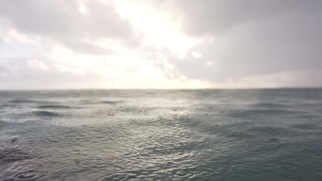 in the sea during a light rain - tropical storm stock videos & royalty-free footage