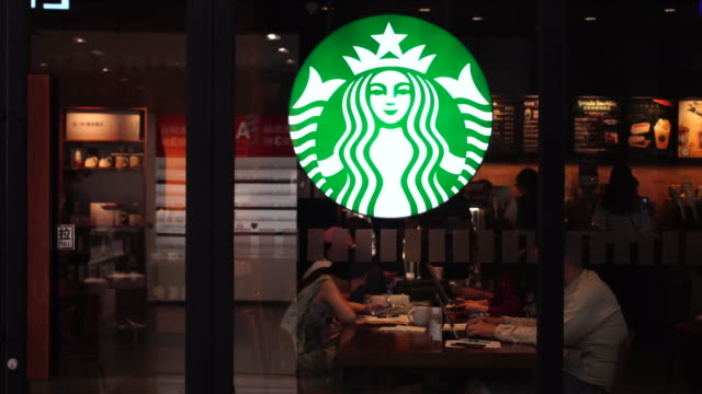 in the second quarter of 2017 starbucks opened its stores to five new cities in china as of now starbucks china has 2628 stores in 127 cities more... - coffee drink stock videos and b-roll footage