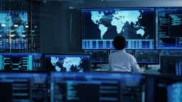 In the System Control Room Chief Operator Watches Screens With Satellite Data. Monitoring Station Has Capacity for Global Data and Monitoring, Every Interaction is Shown in Real Time on Displays