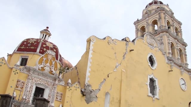in the town of atlixco where the our lady of the nativity church was damaged by the powerful earthquake that struck mexico one day ago exchange... - church of the nativity stock videos and b-roll footage