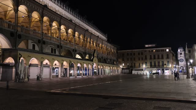 in the video, a general view of piazza della frutta with the palazzo della ragione on the left and the clock of piazza dei signori in the background... - other stock videos & royalty-free footage