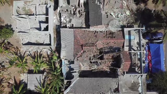 in the village of sugian on indonesia's lombok island the remains of a mosque and houses lie in ruins destroyed by the latest in a series of powerful... - indonesia earthquake stock videos & royalty-free footage