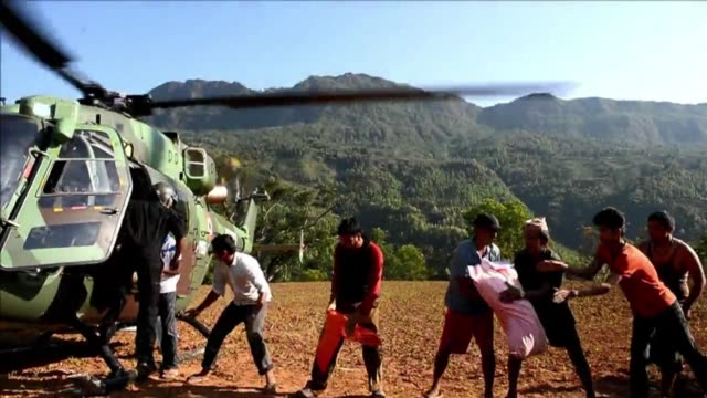 In the wake of an earthquake that devastated Nepal villagers in the Gorkha district helped unload relief from an Indian Army chopper Sunday