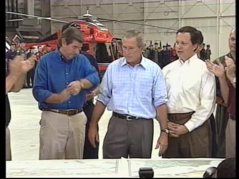in the wake of hurricane katrina president george w bush says you're doing a heck of a job brownie to fema director michael brown - ngクリップ点の映像素材/bロール