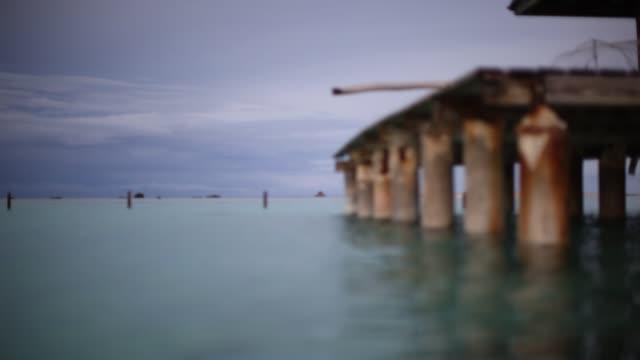 stockvideo's en b-roll-footage met in the water by the dock - franse overzeese gebieden