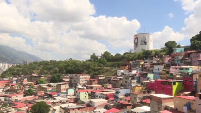 in the western 23 de enero district a hillside slum in the west of caracas where chavez is buried in a military barracks an unusual mood reigns - träns bildbanksvideor och videomaterial från bakom kulisserna