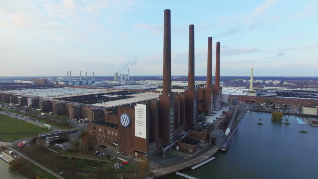 in this aerial clip the volkswagen factory including its heating plant with its four chimneys stands on november 12 2015 in wolfsburg germany... - logo stock-videos und b-roll-filmmaterial