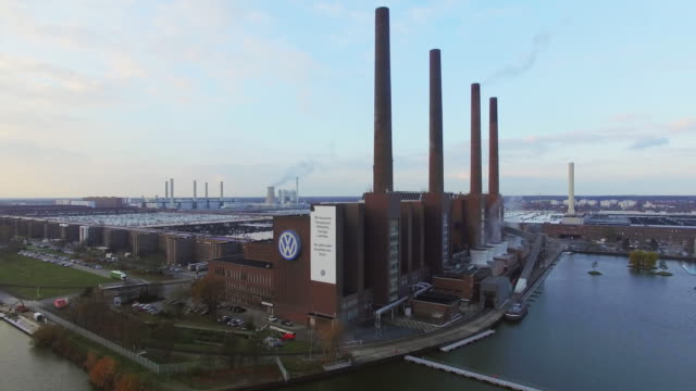 in this aerial clip the volkswagen factory including its heating plant with its four chimneys stands on november 12 2015 in wolfsburg germany... - wolfsburg lower saxony stock videos and b-roll footage