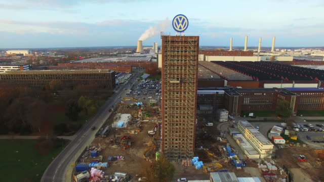in this aerial clip the volkswagen logo adorns the top of an administrative building that is currently under renovation at the volkswagen factory on... - wolfsburg lower saxony stock videos and b-roll footage
