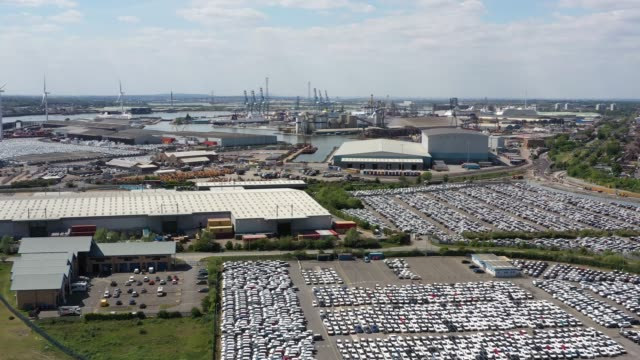 in this aerial drone view new cars sit at tilbury docks during the coronavirus pandemic on may 15 2020 in london england the prime minister announced... - car showroom stock videos & royalty-free footage