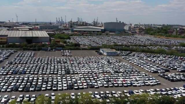 in this aerial drone view, new cars sit at tilbury docks during the coronavirus pandemic on may 15, 2020 in london, england. the prime minister... - parking stock videos & royalty-free footage