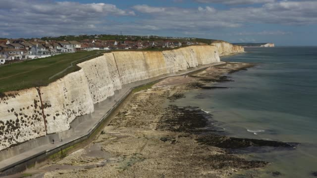 in this aerial drone view, the town of peacehaven sits above the chalk cliffs of the south downs on may 14, 2020 in peacehaven, east sussex. a 2016... - high up stock videos & royalty-free footage