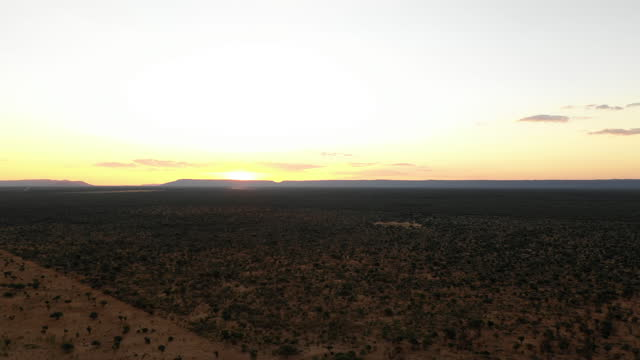 in this aerial image a sunset over the horizon can be seen next to the waterberg plateau, in otjiwarongo, namibia, on april 7, 2019. the waterberg... - sunlight stock videos & royalty-free footage