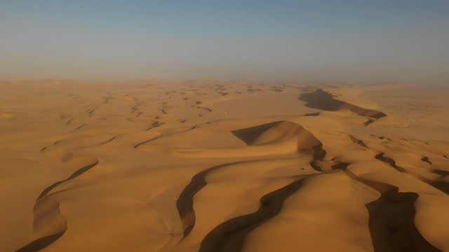 april 2: in this aerial image captured with a drone, sand dunes can be seen at a desert near swakopmund, in namibia, on april 2, 2019. located on the... - sand stock videos & royalty-free footage