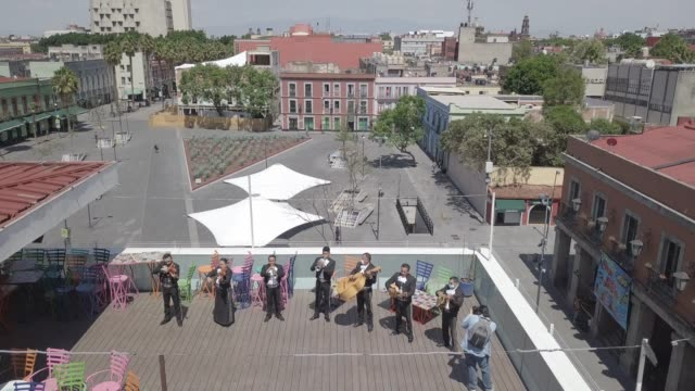 in this aerial photo from a drone a seven member mariachi band of musicians with some wearing protective masks play their instruments as the band... - musiker stock-videos und b-roll-filmmaterial
