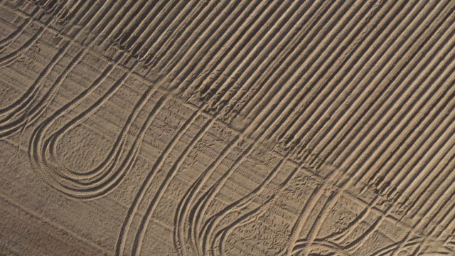 in this aerial view a farmer's field of parched soil lies covered in patterns left by a tractor during very dry weather on april 27, 2020 near... - erdreich stock-videos und b-roll-filmmaterial