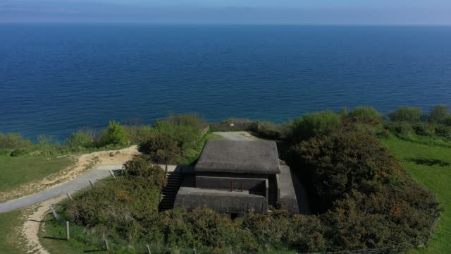 in this aerial view a former german observation bunker looks out at the english channel in normandy on may 3 2019 at longuessurmer france june 6 will... - normandie stock-videos und b-roll-filmmaterial