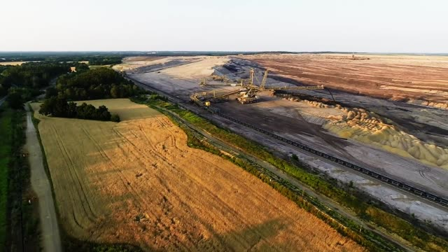 In this aerial view a machine called a spreader dumps earth transported on a conveyor from an active section of the mine at the edge of the Welzow...