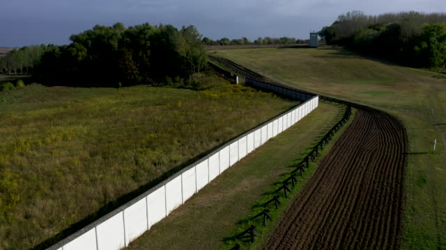 in this aerial view a section of the former cold warera fortified border between east germany and west germany including a wall antivehicle... - flutlichter stock-videos und b-roll-filmmaterial