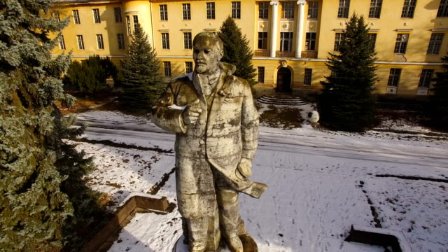 In this aerial view a statue of Vladimir Lenin stands overlooking a vista in front of the officers' building at the former Soviet military base on...