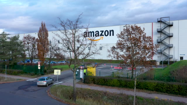 in this aerial view, an amazon packaging center is photographed on november 28, 2019 in brieselang, germany. amazon is anticipating a strong holiday... - big tech stock videos & royalty-free footage