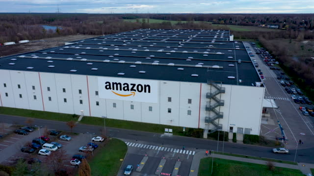in this aerial view, an amazon packaging center is photographed on november 28, 2019 in brieselang, germany. amazon is anticipating a strong holiday... - amazon region stock videos & royalty-free footage