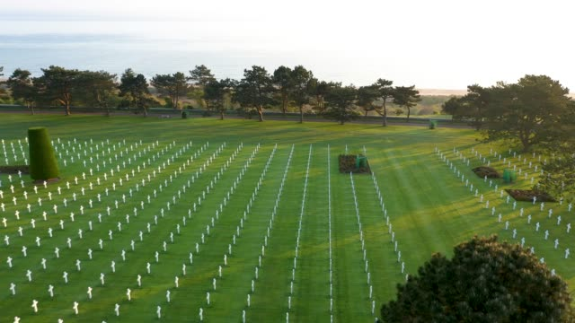 in this aerial view crosses stand over graves at normandy american cemetery on april 30, 2019 at colleville-sur-mer, france. the cemetery contains... - d day stock videos & royalty-free footage