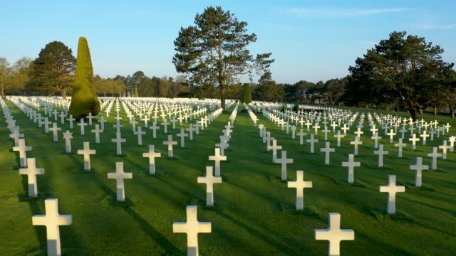 in this aerial view crosses stand over graves at normandy american cemetery on april 30 2019 at collevillesurmer france the cemetery contains the... - normandie stock-videos und b-roll-filmmaterial