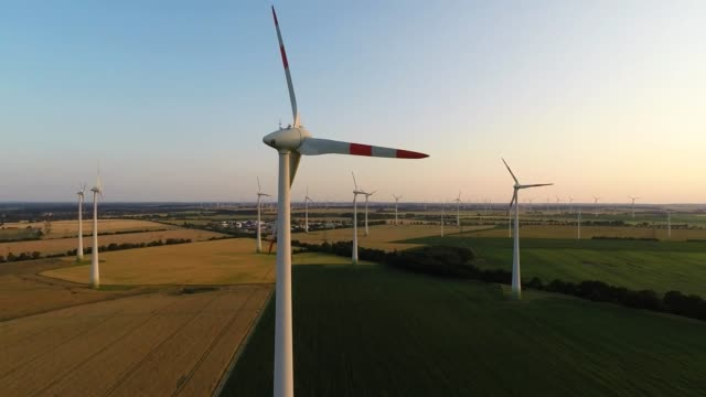in this aerial view electricity-producing wind turbines spin at a wind farm on july 6, 2015 near brieselang, germany. according to recent statistics... - brandenburg state stock videos & royalty-free footage