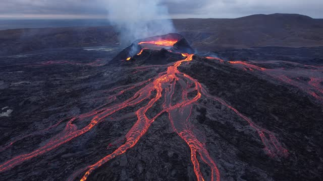 in this aerial view fargradalsfjall volcano spews molten lava on august 19, 2021 near grindavik, iceland. iceland is feeling a strong impact from... - lava stock videos & royalty-free footage