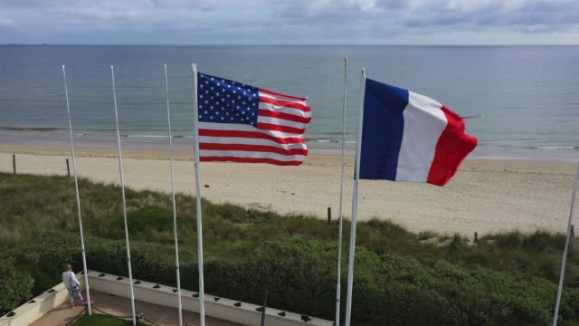 in this aerial view french and us flags fly at utah beach in normandy on may 2 2019 near saintemariedumont france june 6 will mark the 75th... - french flag stock videos & royalty-free footage