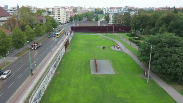 in this aerial view from a drone, a section of the former berlin wall, complete with a guard tower, that is now a memorial at bernauer strasse,... - war stock-videos und b-roll-filmmaterial