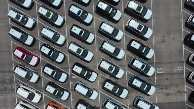 in this aerial view from a drone, brand new subaru cars sit in an auto warehouse co. storage lot on april 30, 2020 in richmond, california. as people... - subaru stock videos & royalty-free footage
